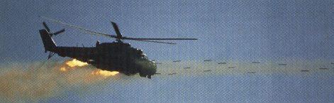 HIND PERUANO haciendo fuego con sus pods de cohetes de 57 mm.